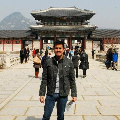 The author, posing gamely at a palace in Seoul, Korea
