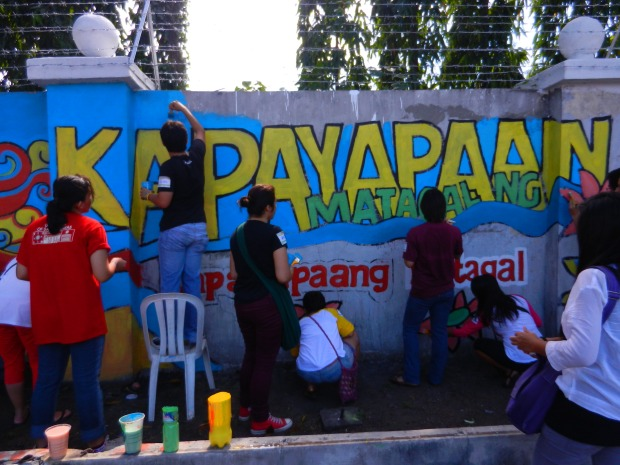 Volunteers painted the walls of Camp Aguinaldo during Project EDSA in June