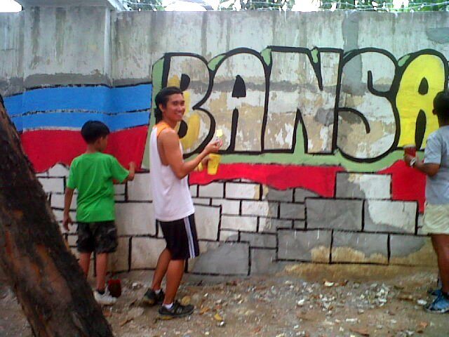 The author, getting his hands dirty on the walls of Camp Aguinaldo